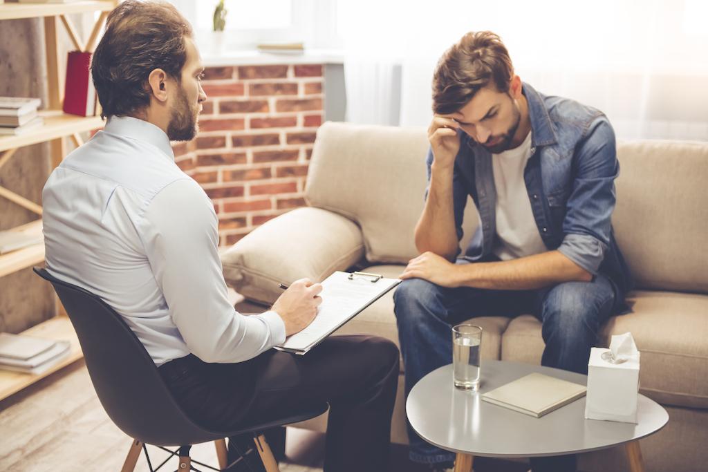white man talking to male therapist