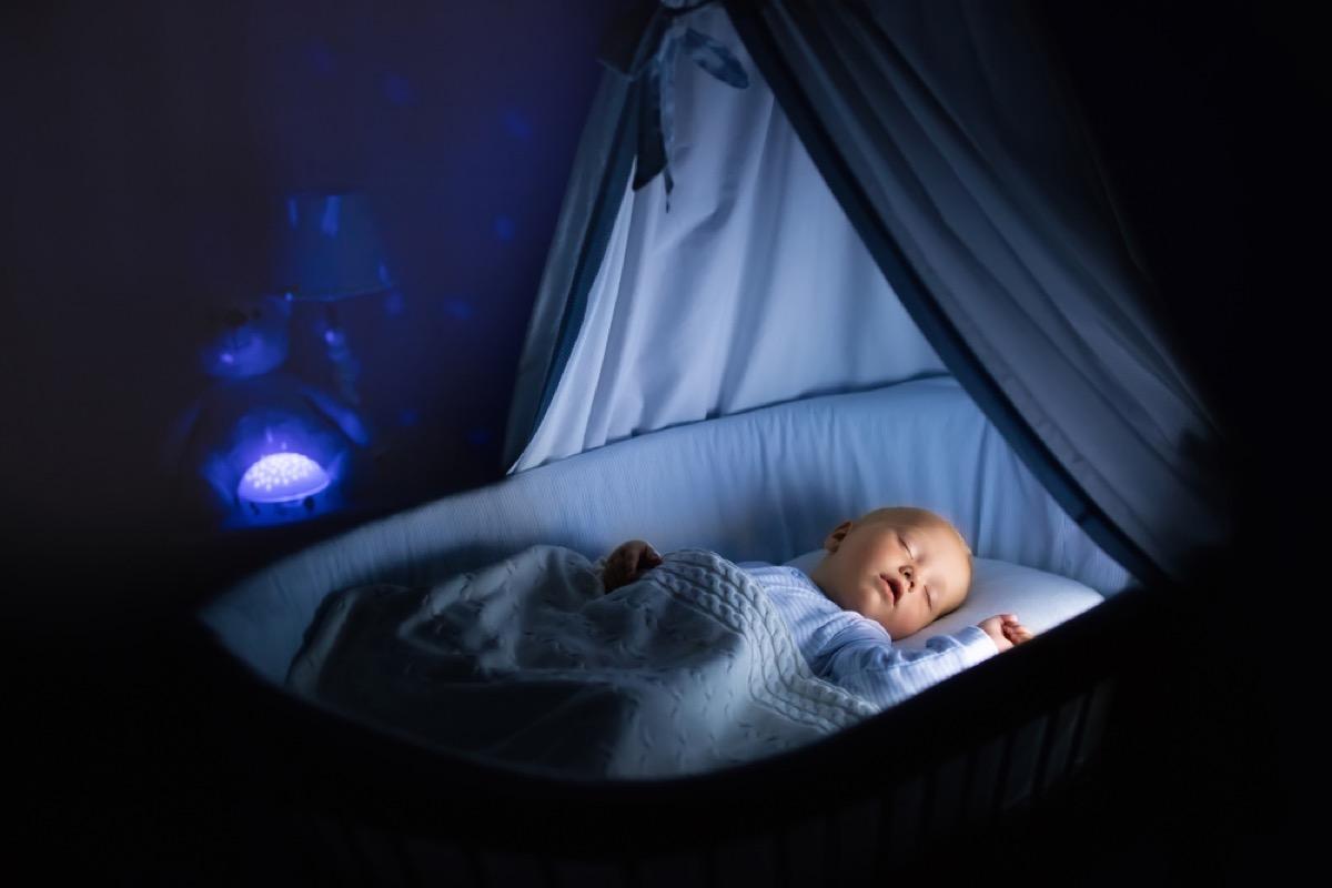 baby sleeping in nursery at night, ways parenting has changed.