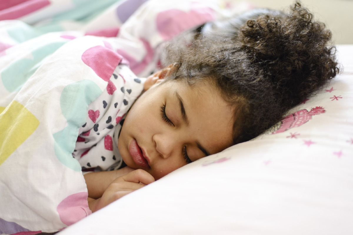 little girl asleep in bed, bad parenting advice