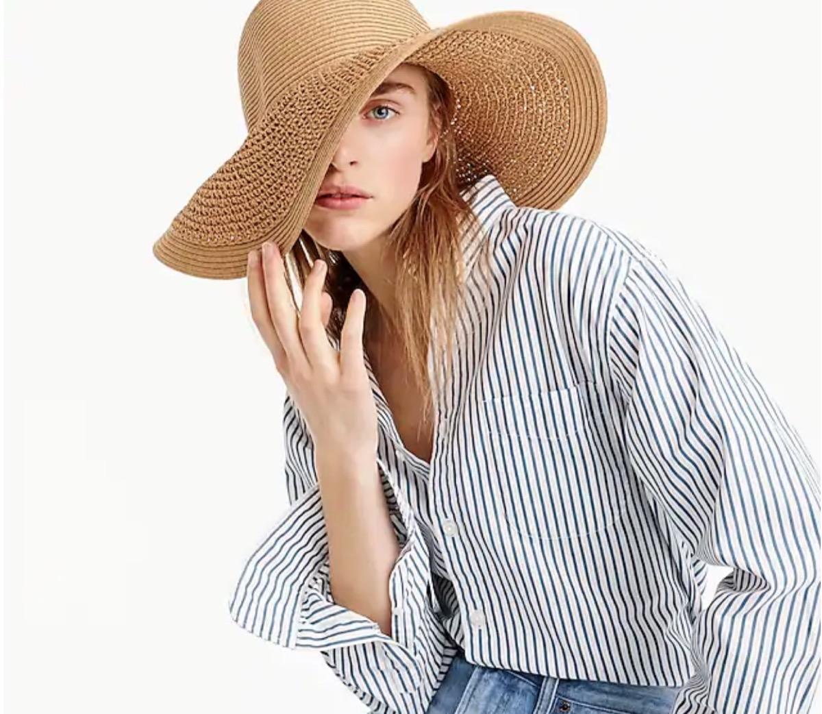 woman wearing tan floppy straw hat, summer buys under $100