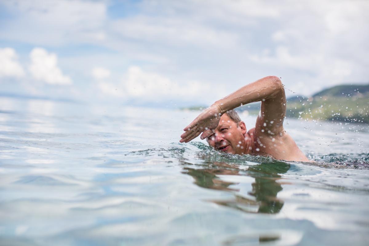 Older man swimming in ocean