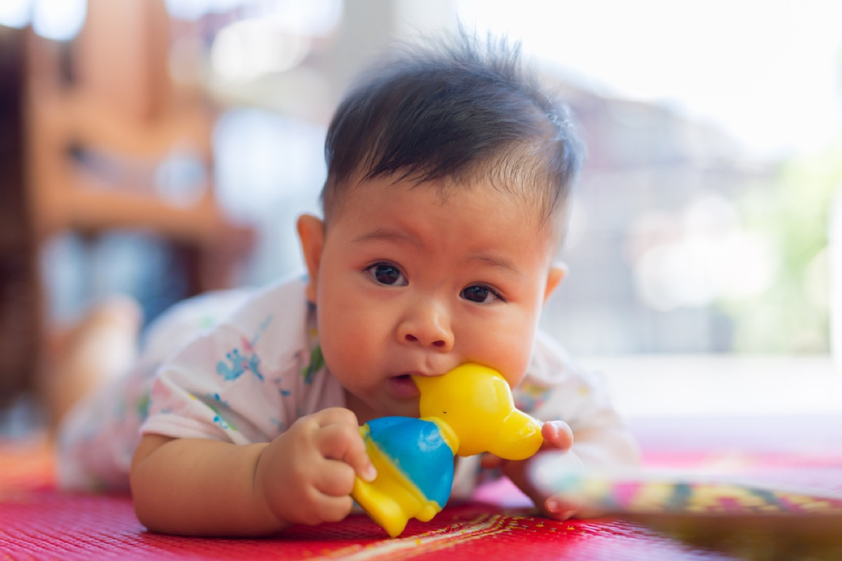 baby chewing on toy, bad parenting advice