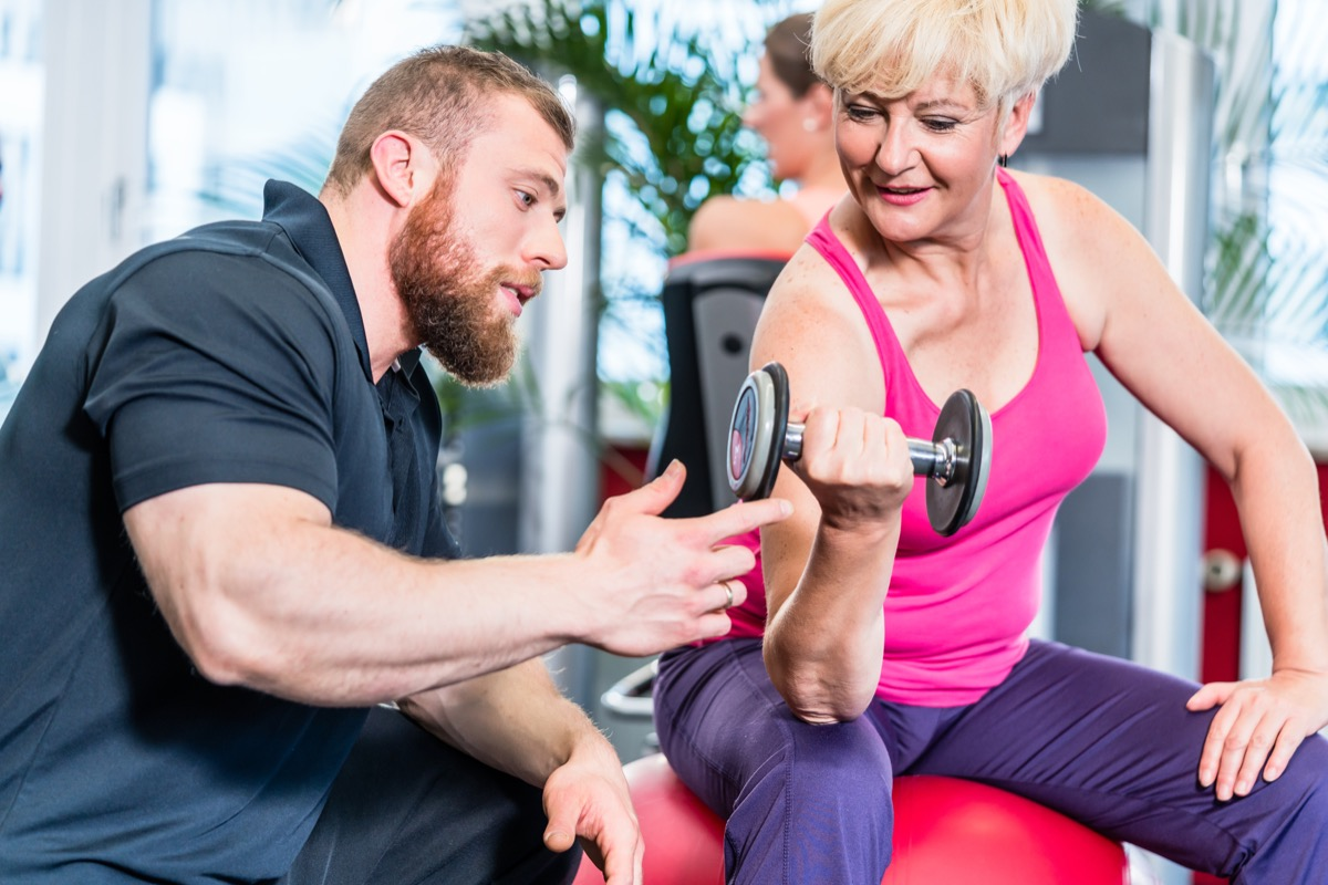 Older woman with a personal trainer