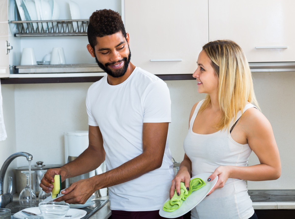 Two People Cleaning Dishes at the Sink BBQ Etiquette Mistakes
