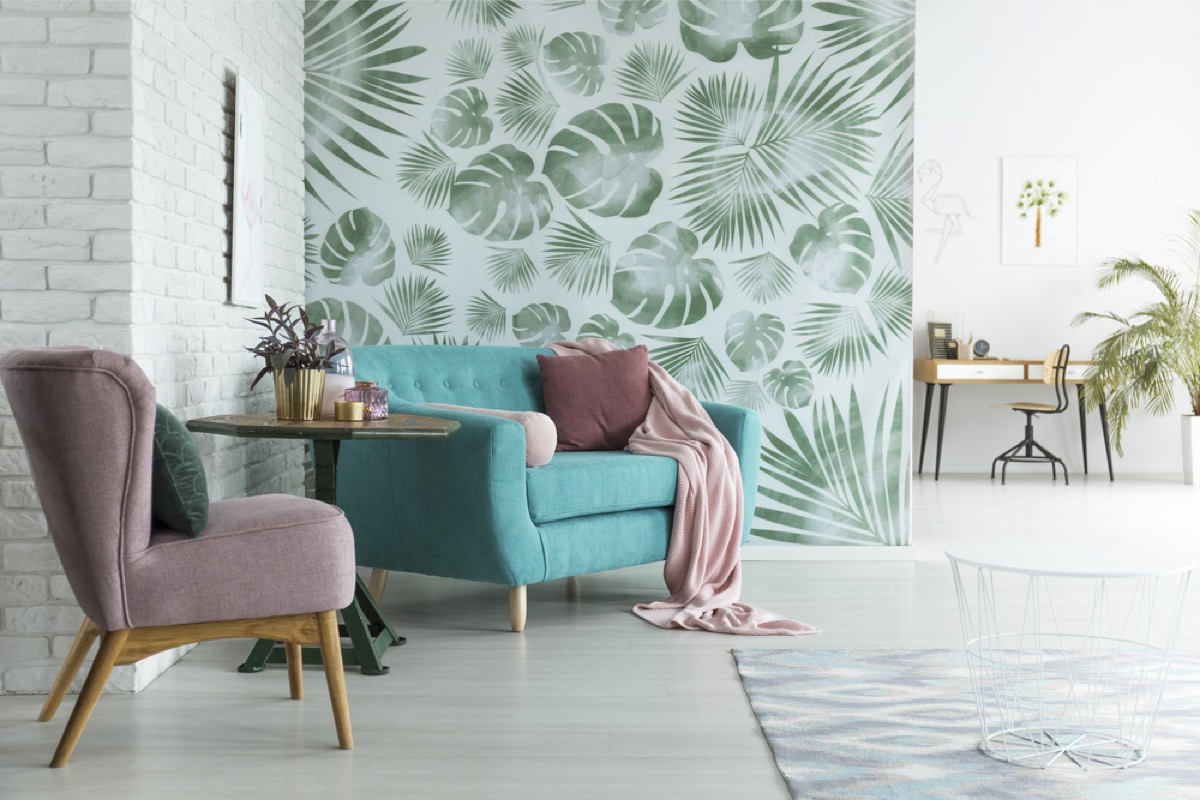 open concept room with wallpapered wall, joanna gaines tips