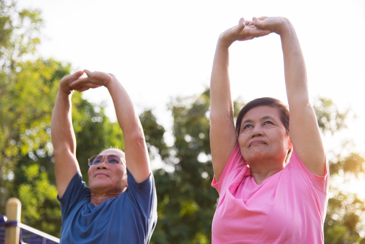 Older people stretching warming up