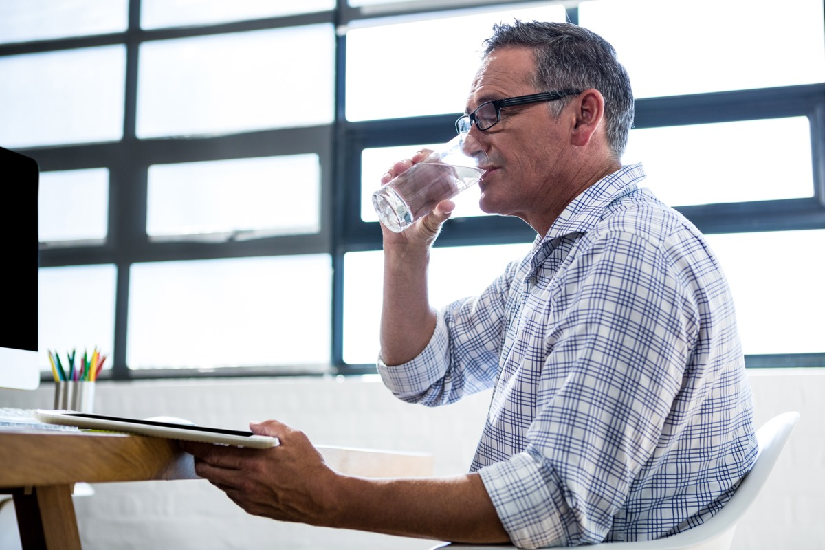 Man drinking glass of water