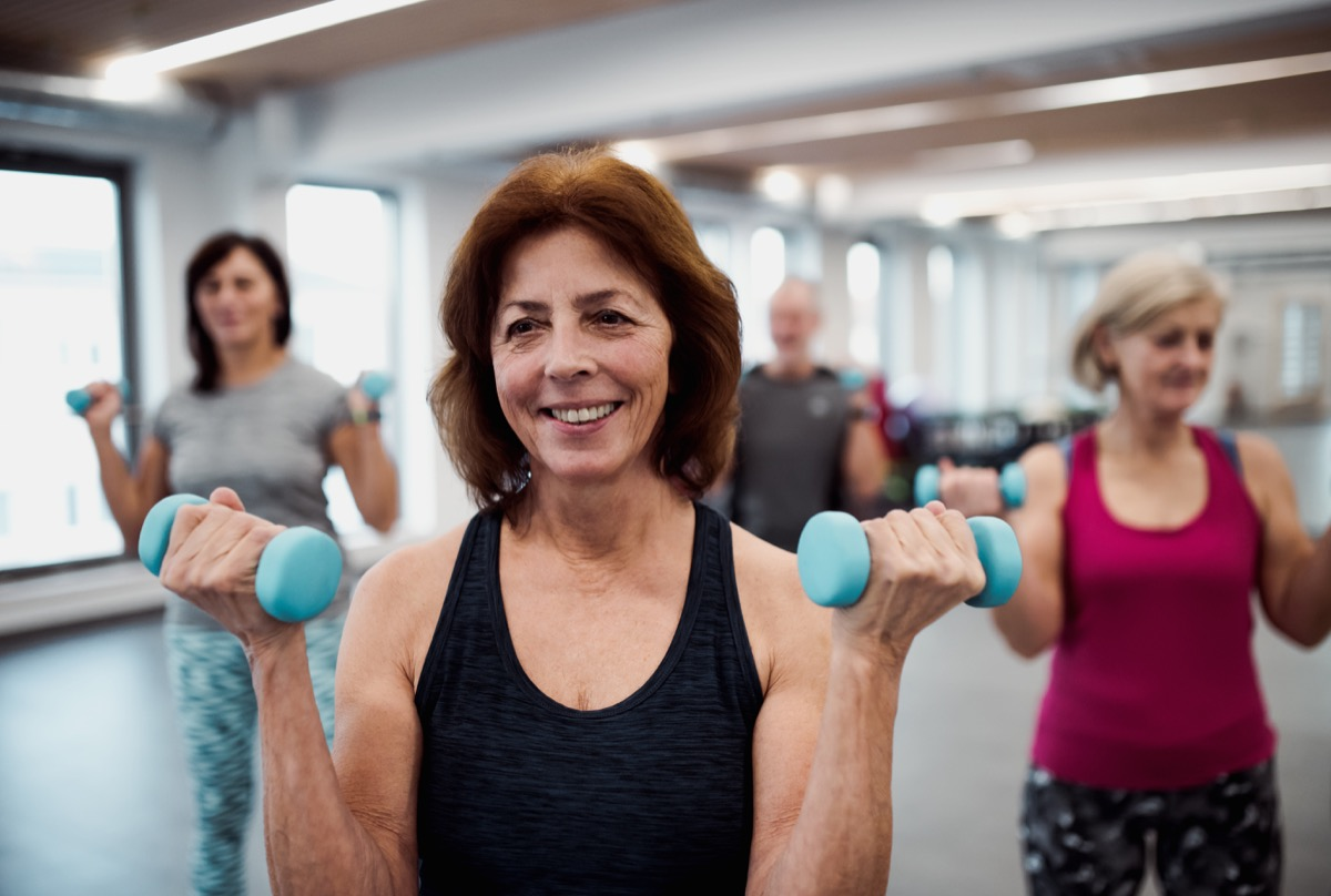 Older gym class lifting weights
