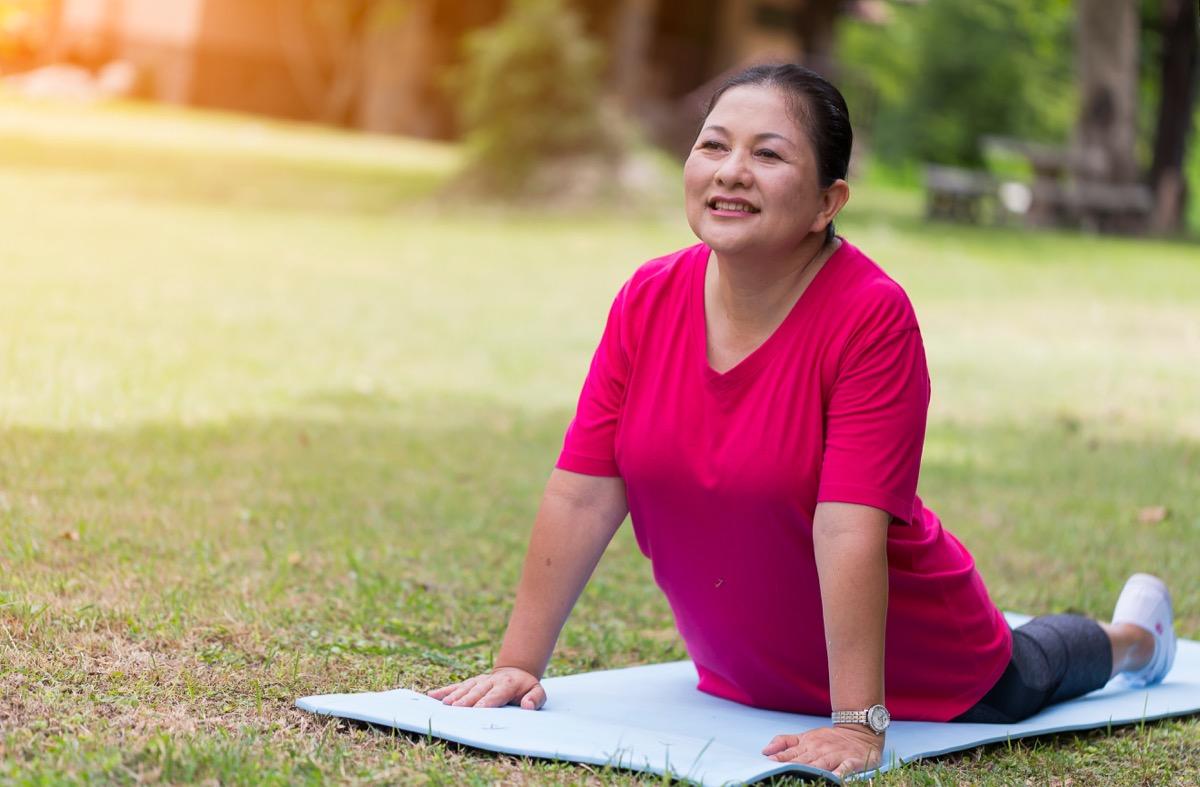 woman doing yoga, over 50 fitness