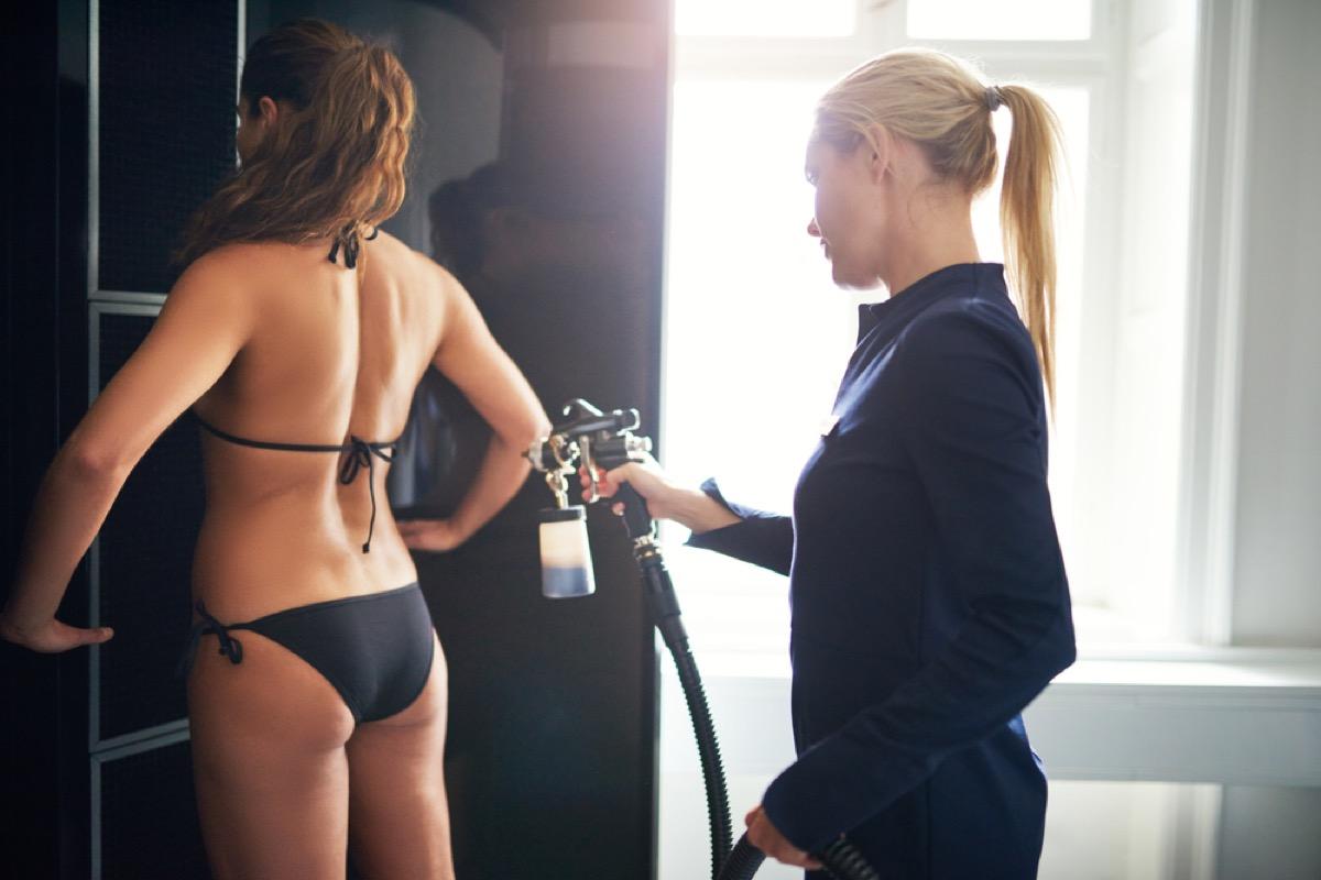woman in bikini getting spray tan, make yourself more attractive