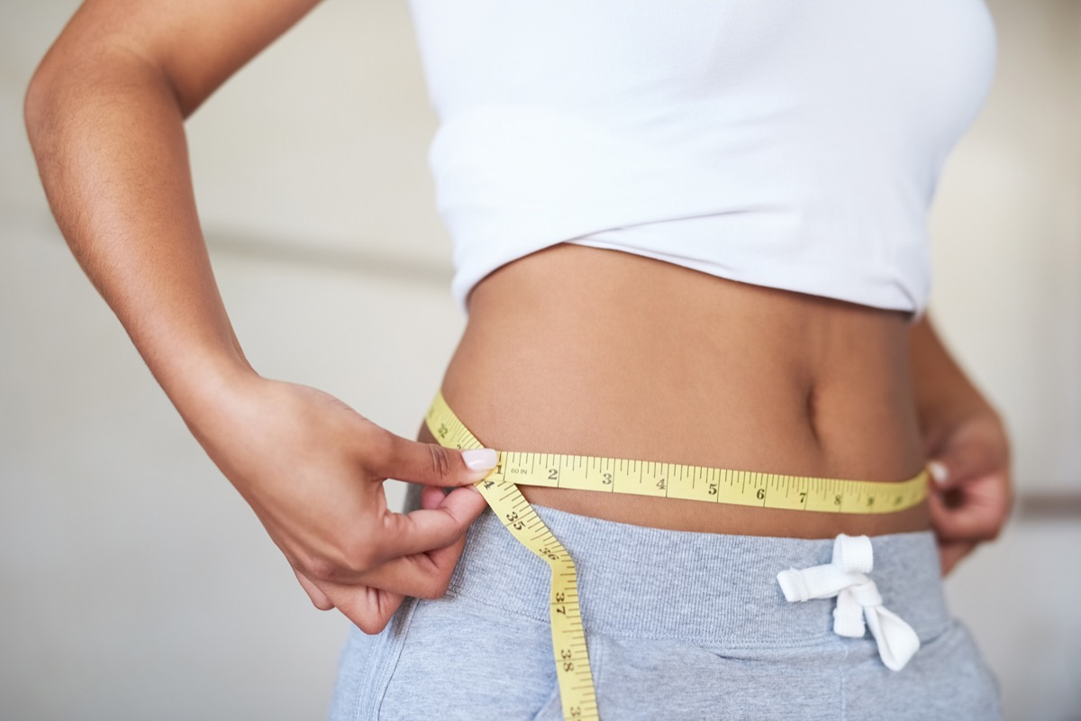 Woman Measuring Her Waist for Weight Gain