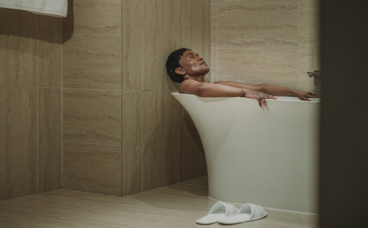woman relaxing in the bath tub, over 40 fitness