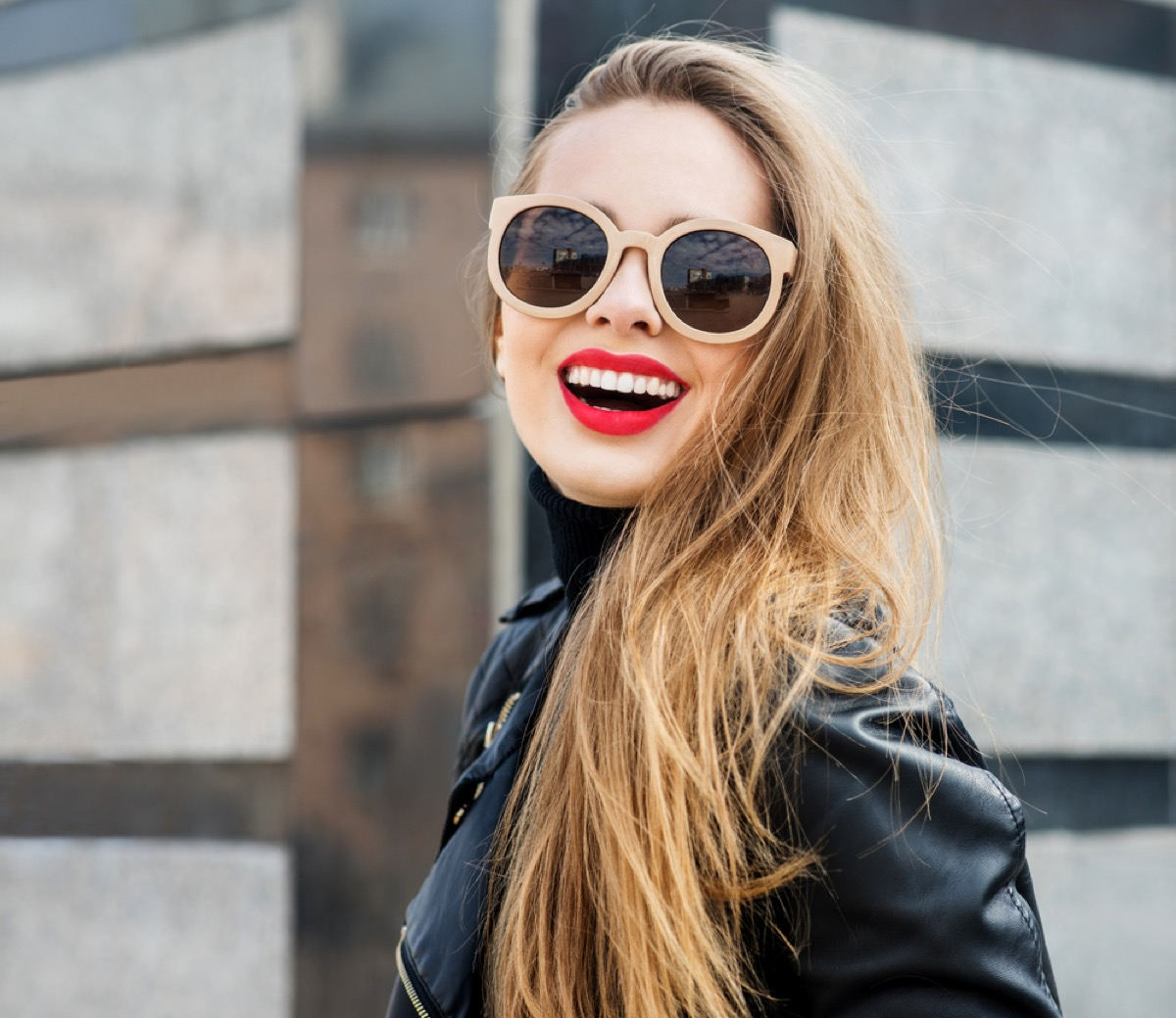 woman standing outside with red lipstick and sunglasses, make yourself more attractive