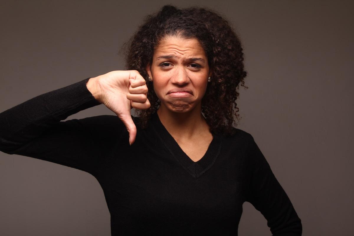 Black Woman Giving a Thumbs Down Keep It Slang Terms