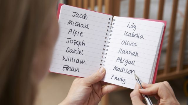 woman writing down a list of baby names, things that annoy grandparents