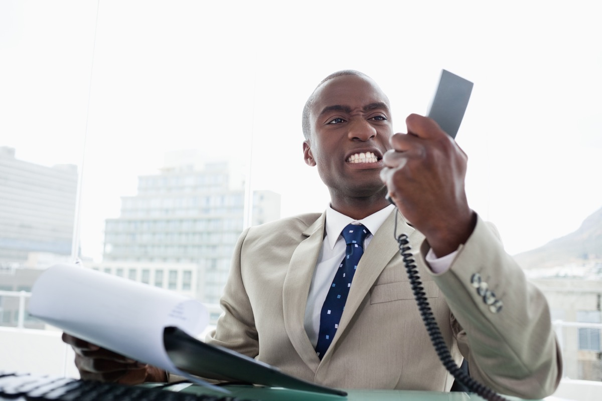 Angry black businessman on phone, things not to say to customer service