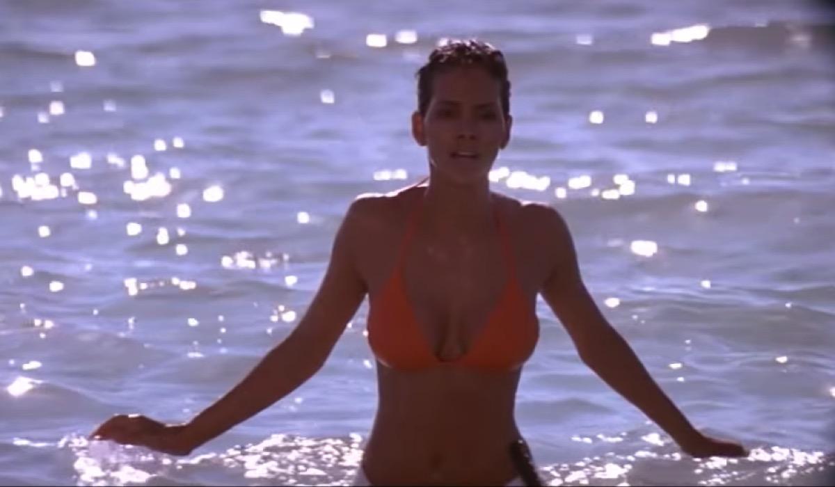 Halle Berry emerges from ocean in orange bikini in Die Another Day, James Bond movie