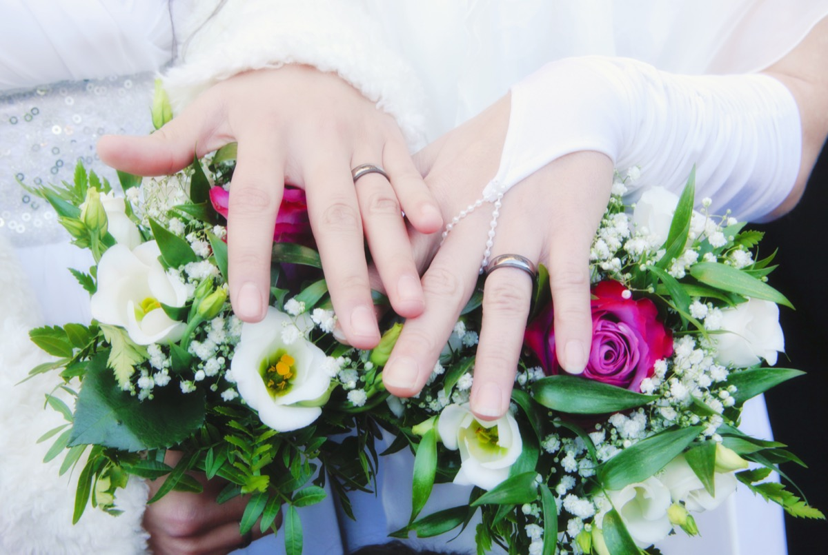 lesbian couple shows wedding bands, craziest things brides and grooms have ever done at weddings