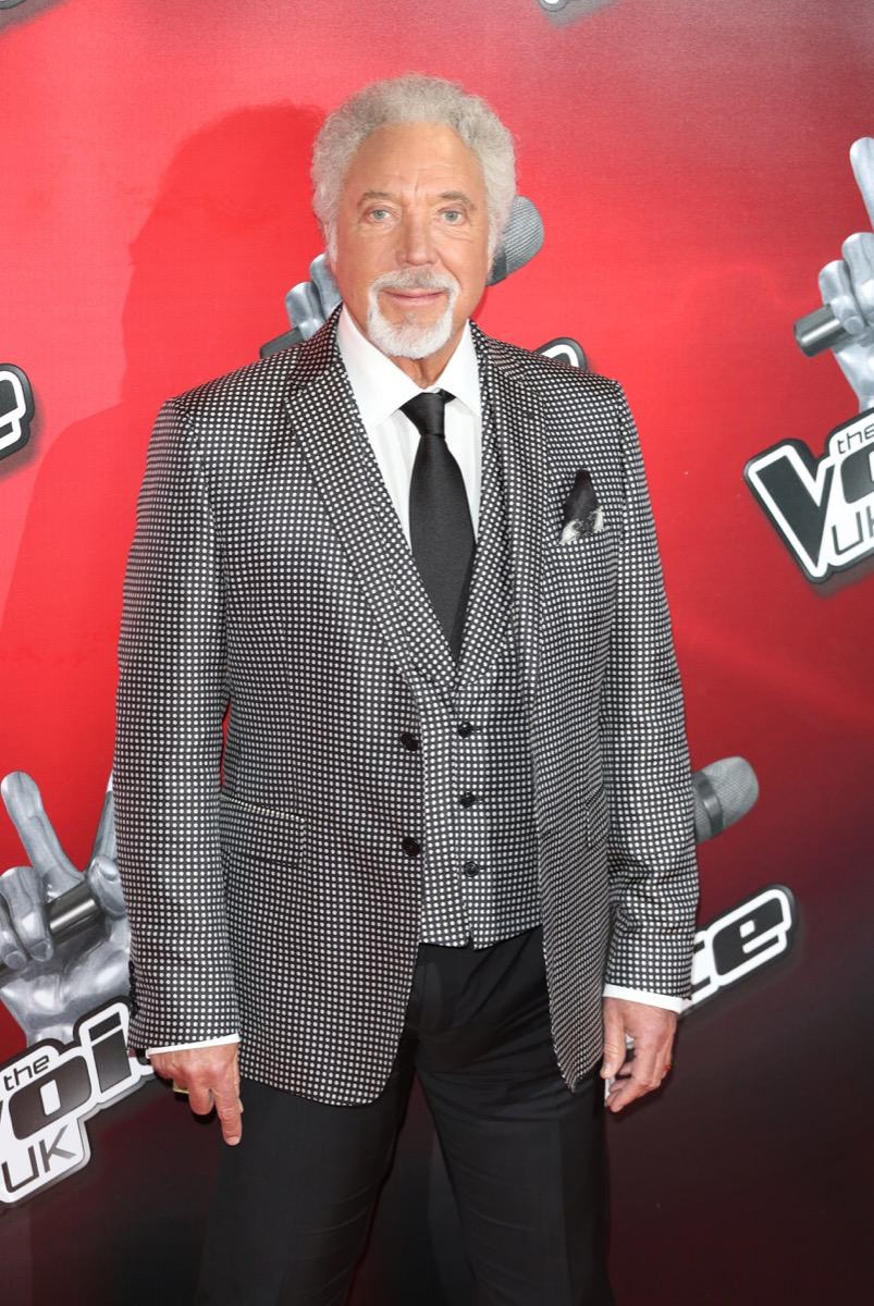 Tom Jones stands in grey three piece suit with grey hair, offended by Prince Philip among his controversial moments