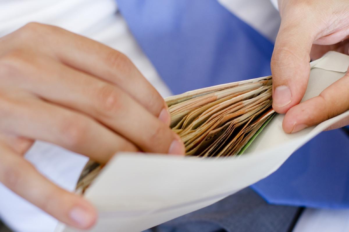 envelope with cash, bad parenting