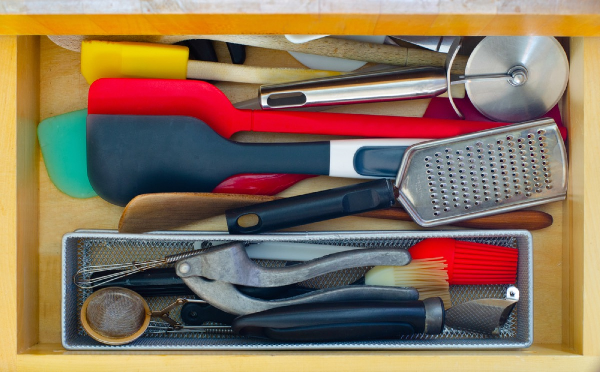 cluttered kitchen drawer, spatulas, downsizing your home