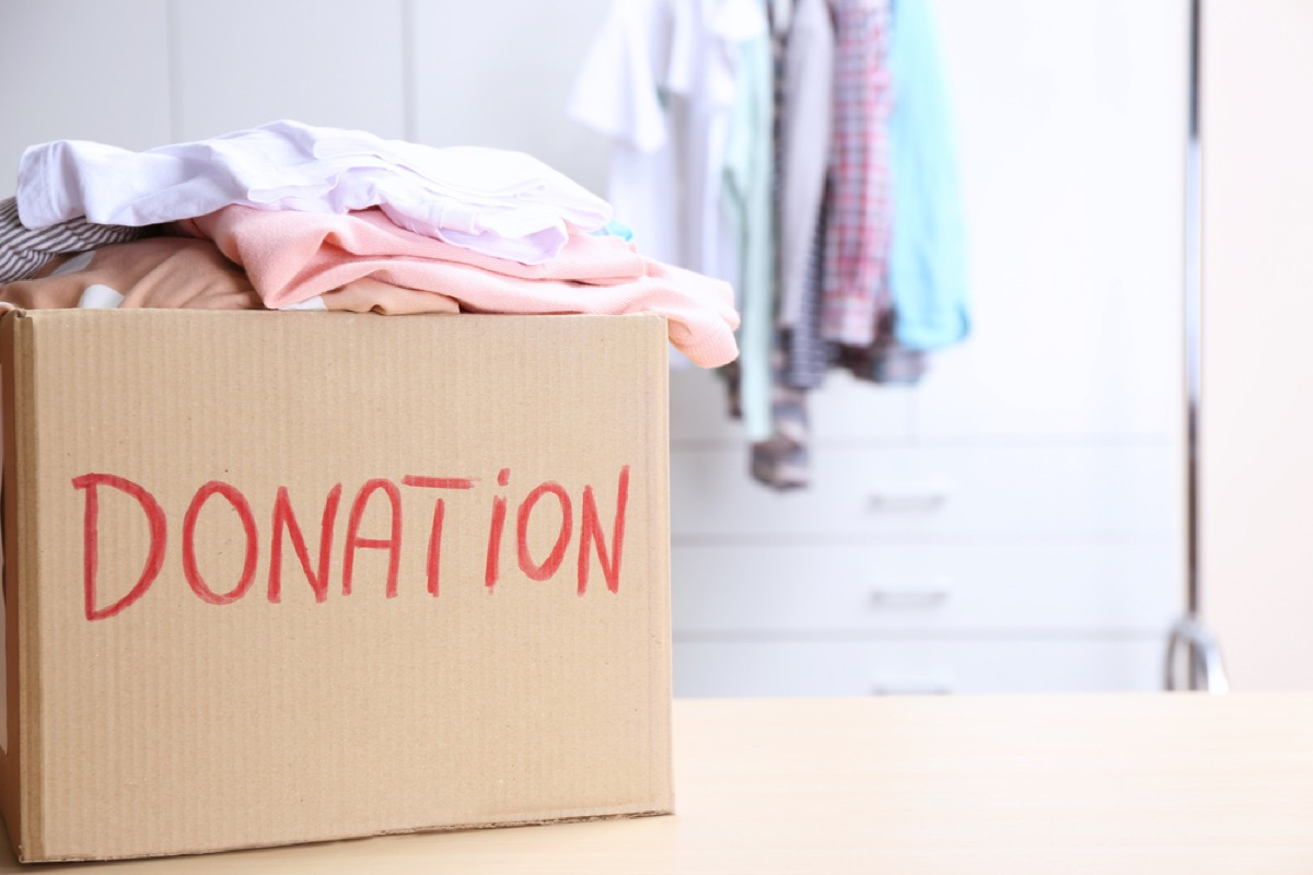 clothing in donation box, downsizing your home