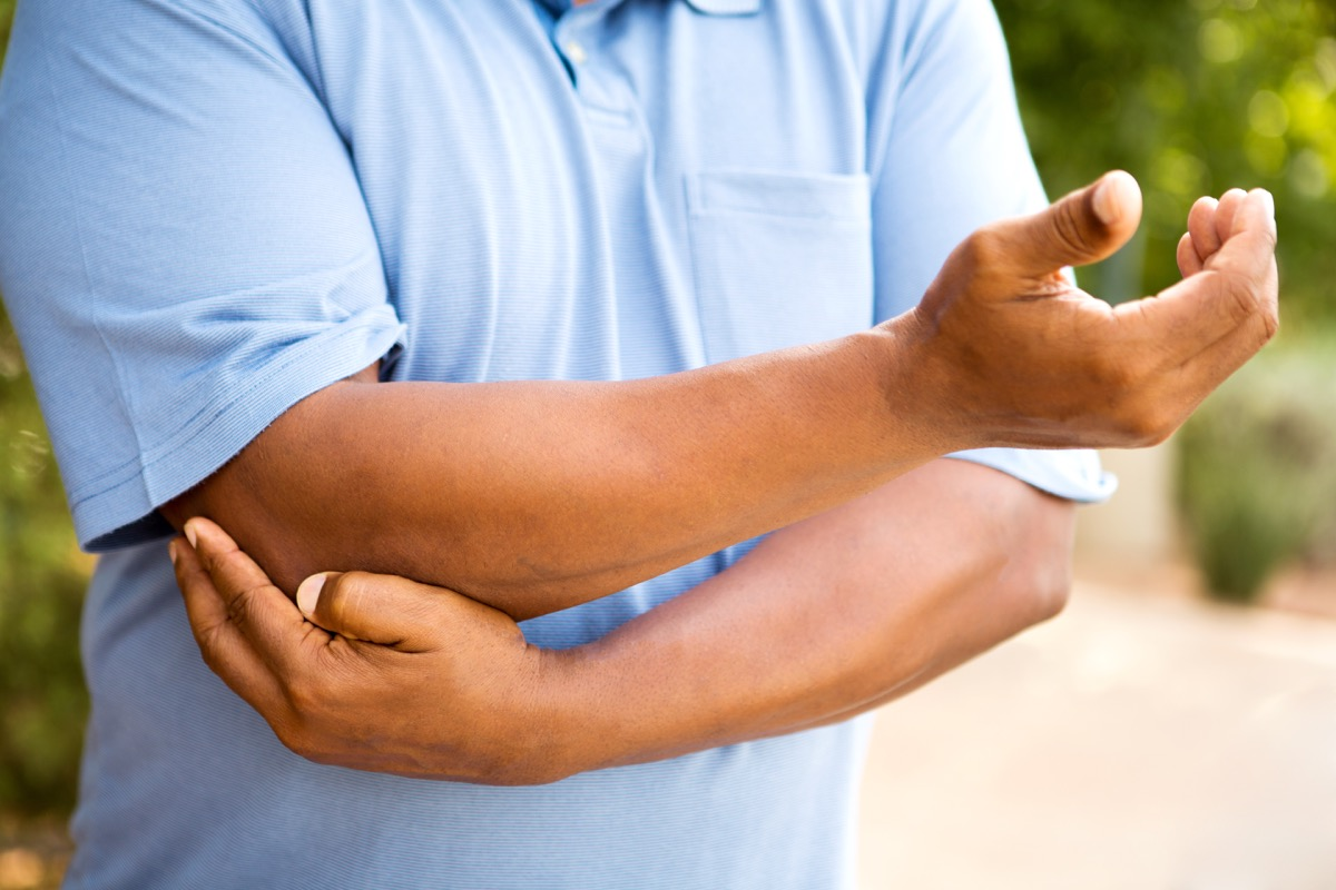 Man with Joint Pain in his Elbow Signs of Poor Health Over 50
