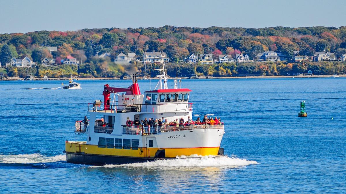 a ferry shuttles passengers in casco bay in portland maine