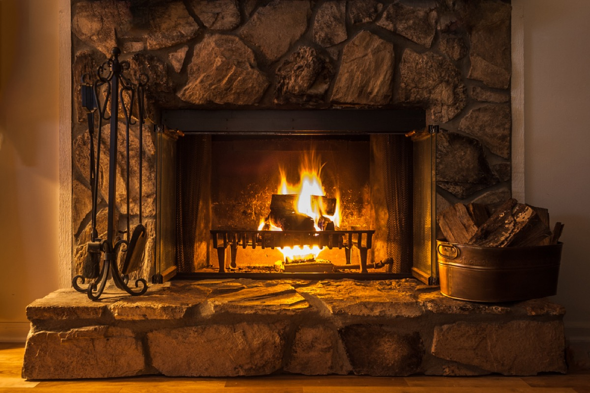 fireplace with stone surround, things you shouldn't store in your basement