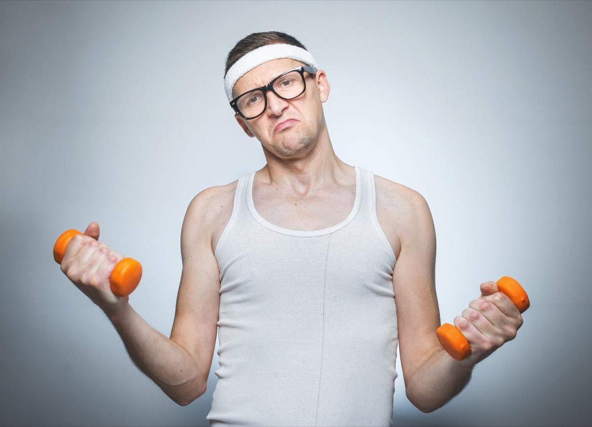 man lifting little 5 pound weights