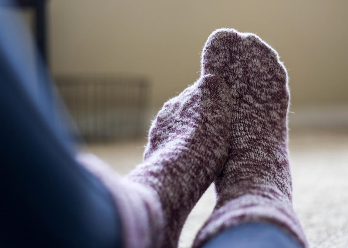 Woman Wearing Fuzzy Socks Aching Feet