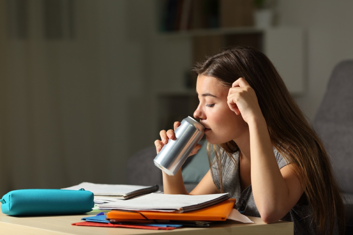 teen drinking out of a can while studying, parenting is harder