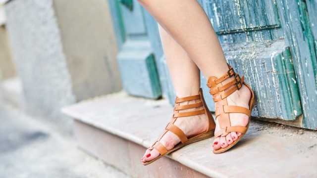 woman wearing leather sandals outdoors, affordable sandals