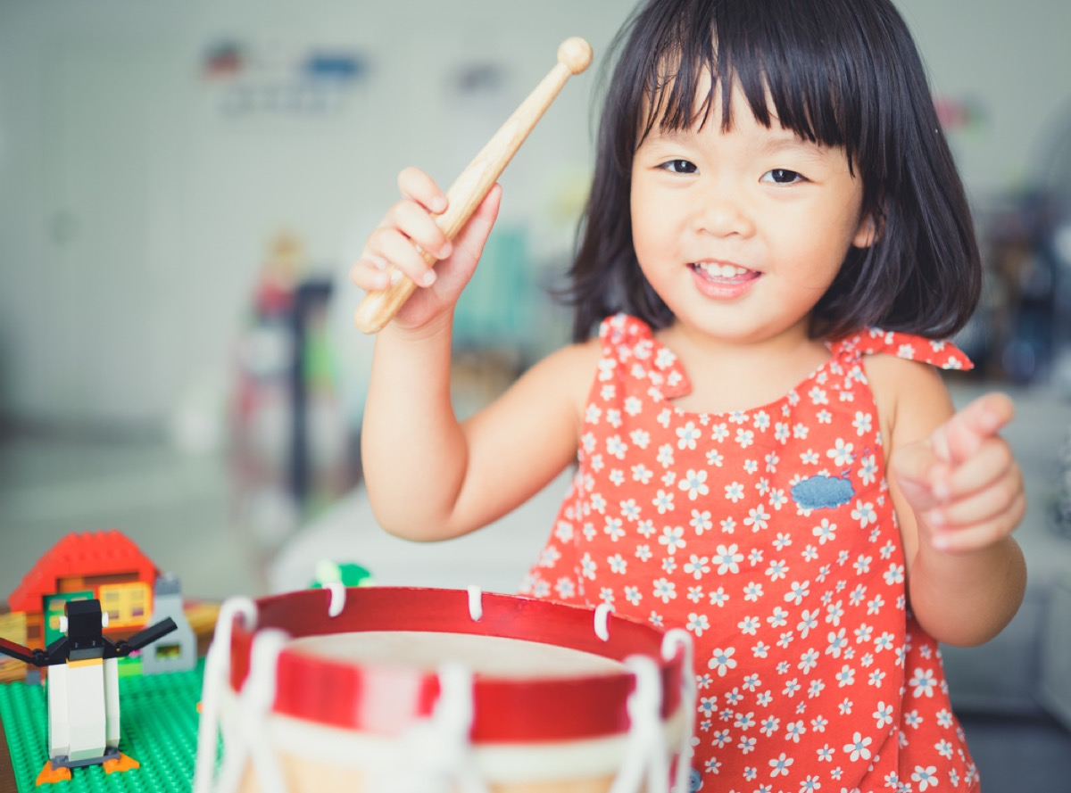 little kid playing toy drum, empty nester