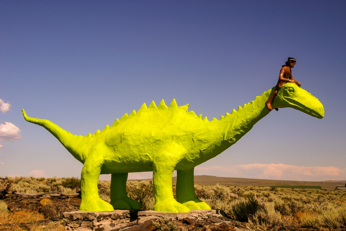 green dinosaur and native american statue shoshone oklahoma famous state statues