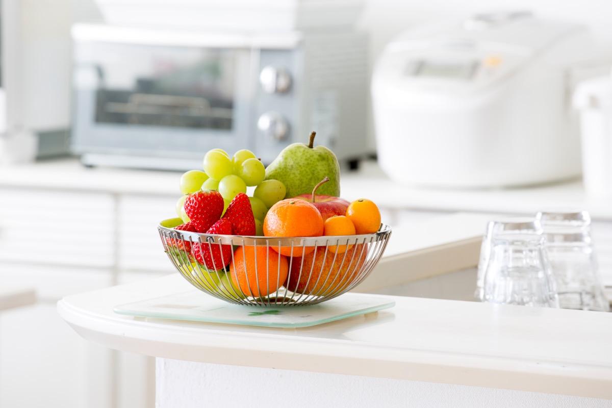 Basket of fruit in white kitchen