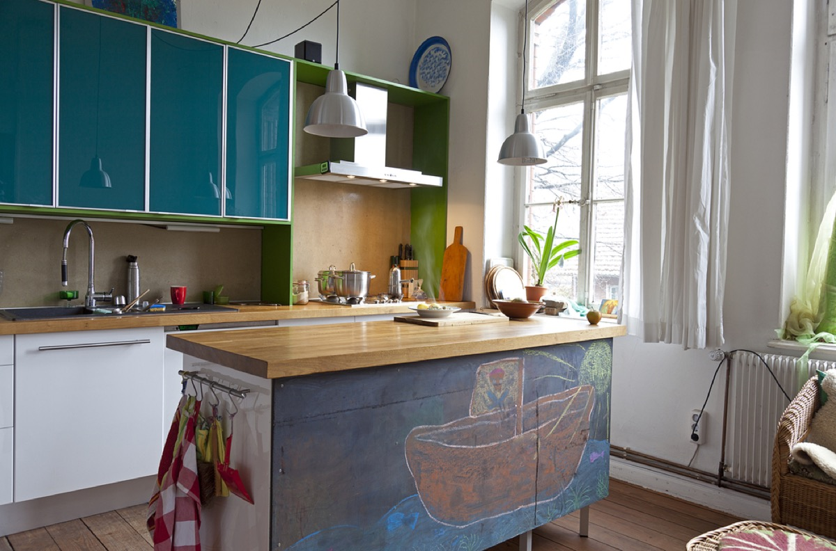modern kitchen with chalk painted island and teal cabinets