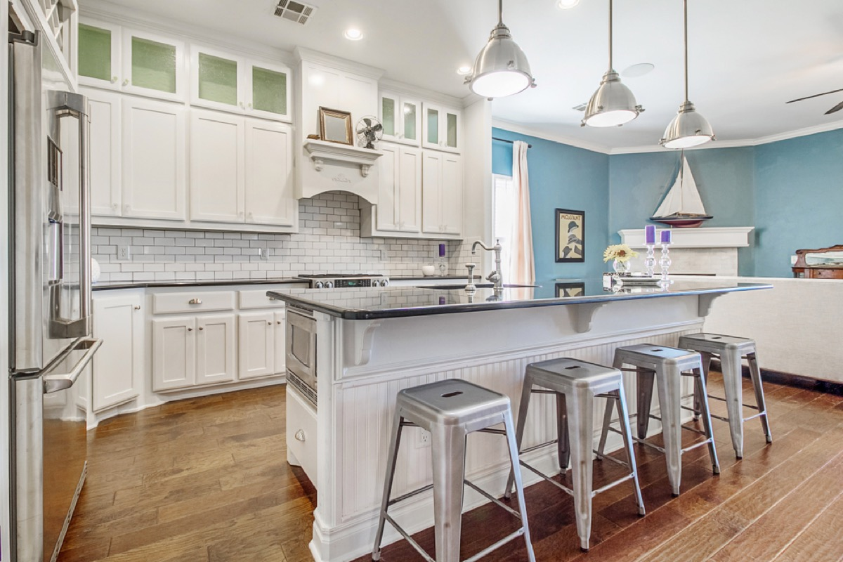 modern kitchen with island and metal barstools