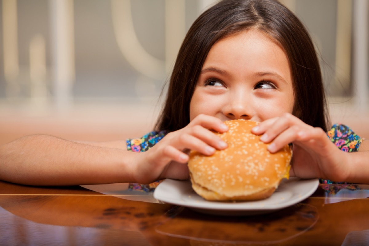 little girl eating hamburger, bad parenting advice