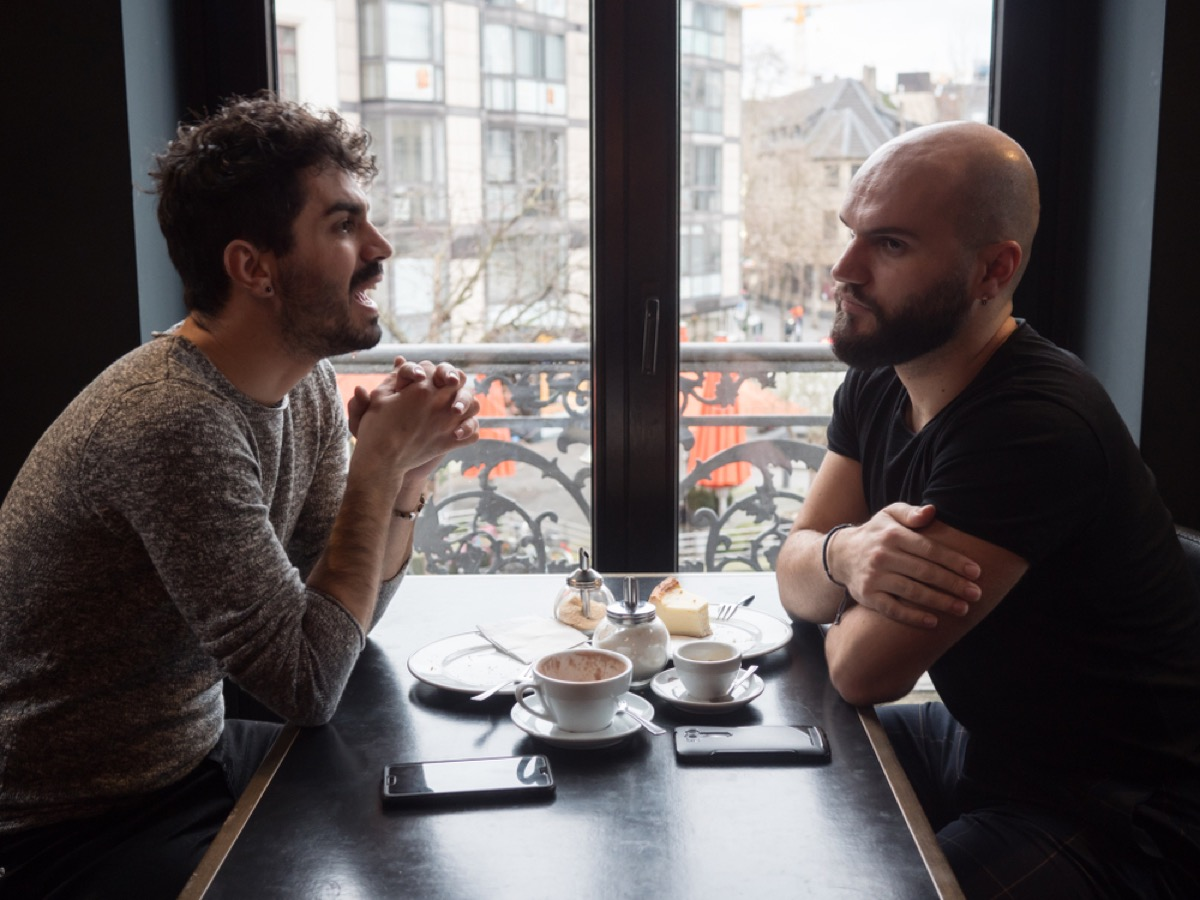 couple arguing over lunch, things you should never say to your spouse