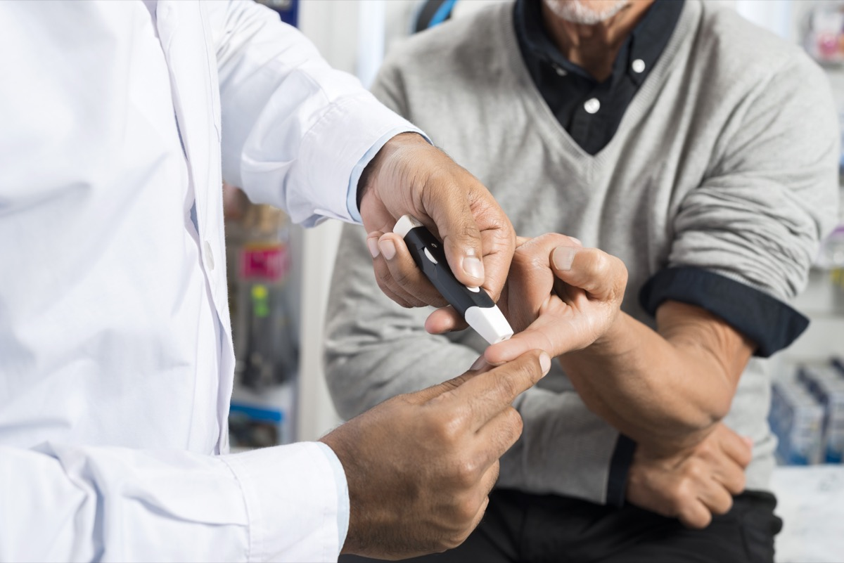 man getting a diabetes test at the doctors office