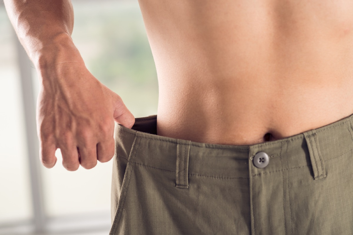 man tugging at the waistband of his pants, subtle symptoms of serious disease