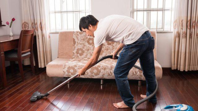 man vacuuming floors, easy home tips