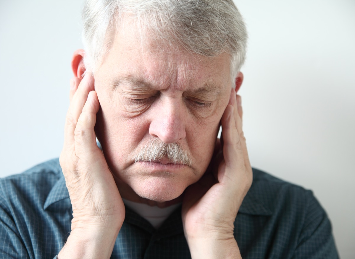 man with jaw pain and gray hair, health concerns over 40 for men
