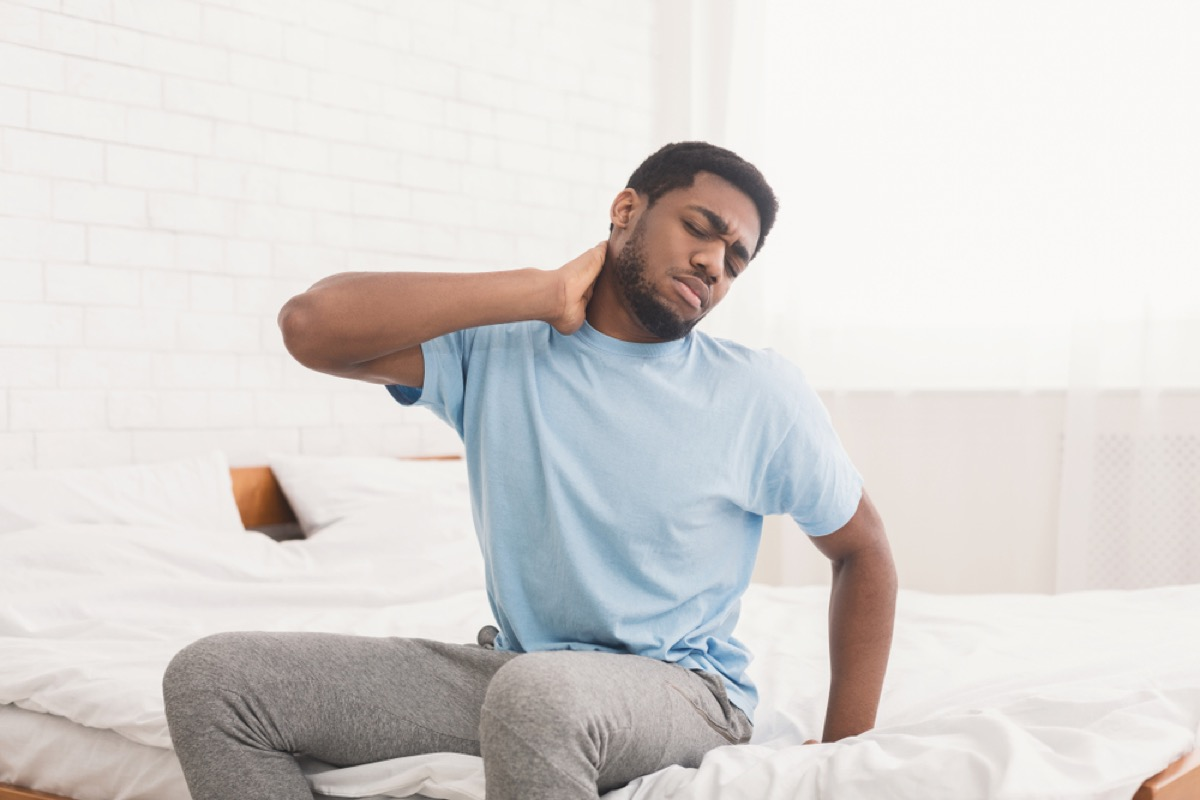 man with neck and back pain, signs you need a new mattress