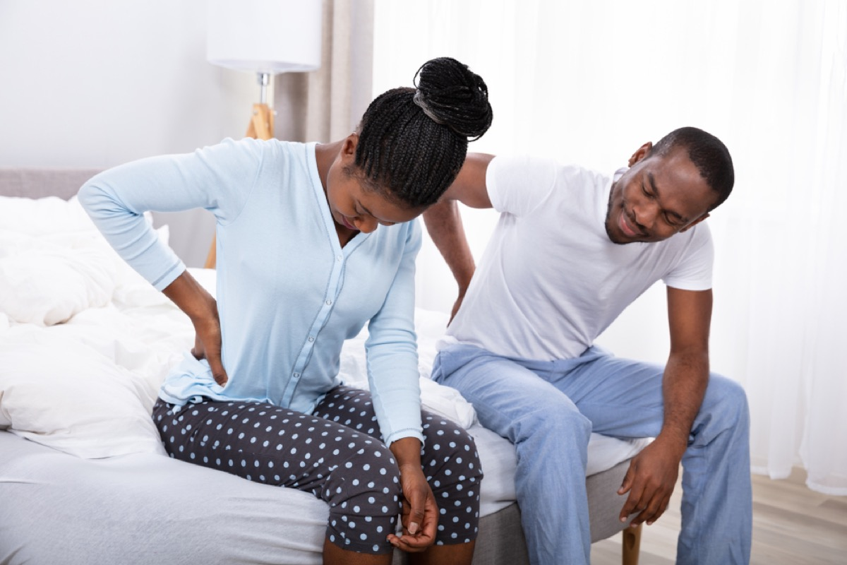couple with back pain, signs you need a new mattress