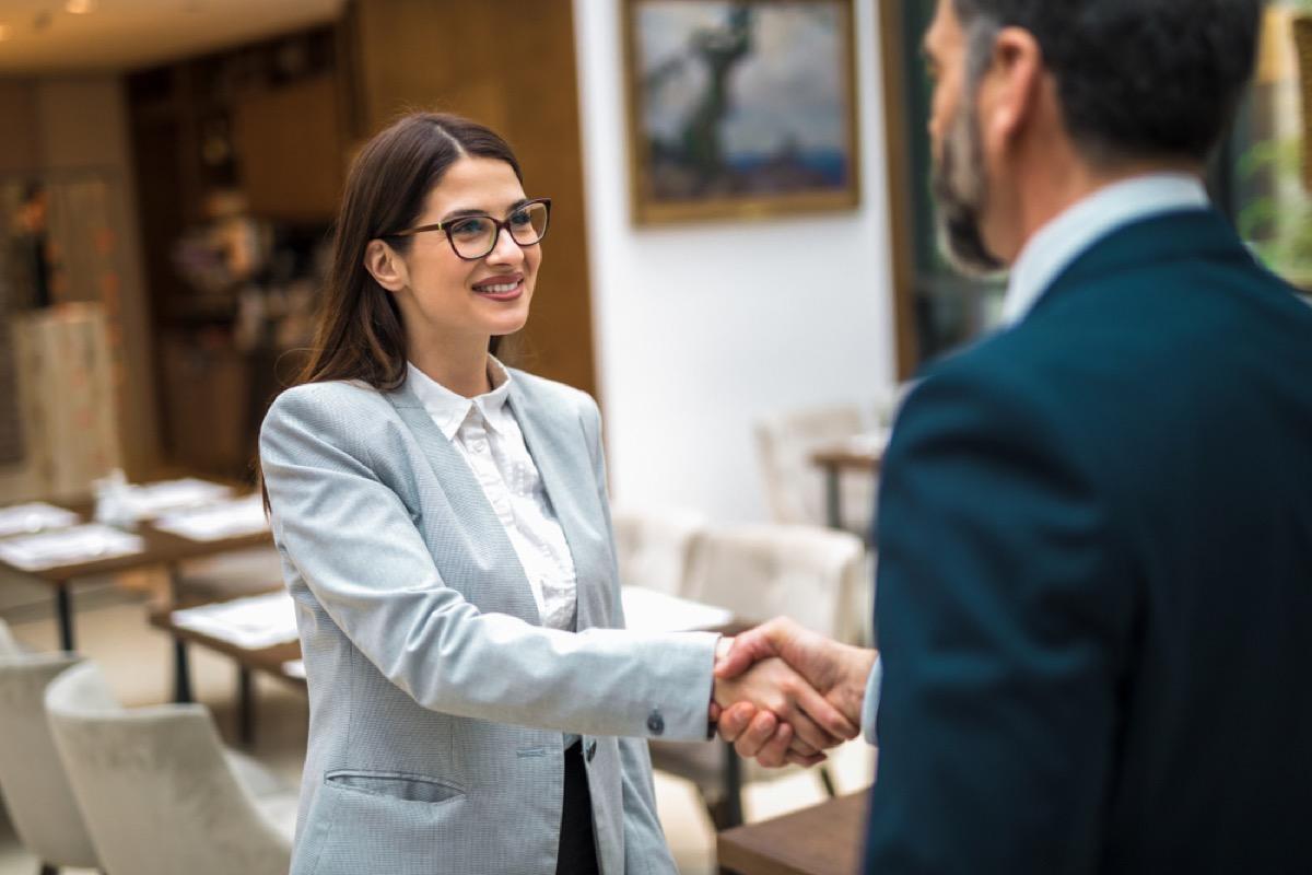 colleagues shaking hands, handshake, office etiquette