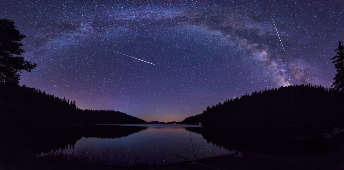 Meteor shower over body of water