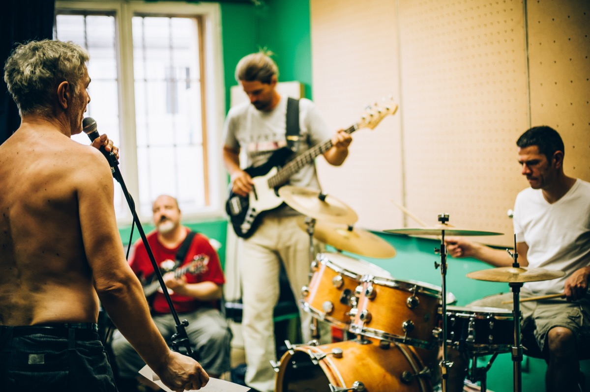 men in their 40s playing in a garage band