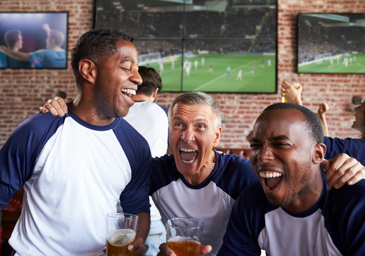 middle-aged men in a sports bar